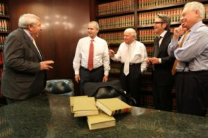 finz & finz team photo inside office