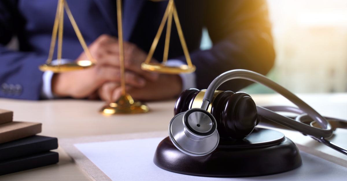 gavel and stethoscope on a desk