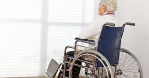 lonely senior woman in a wheelchair