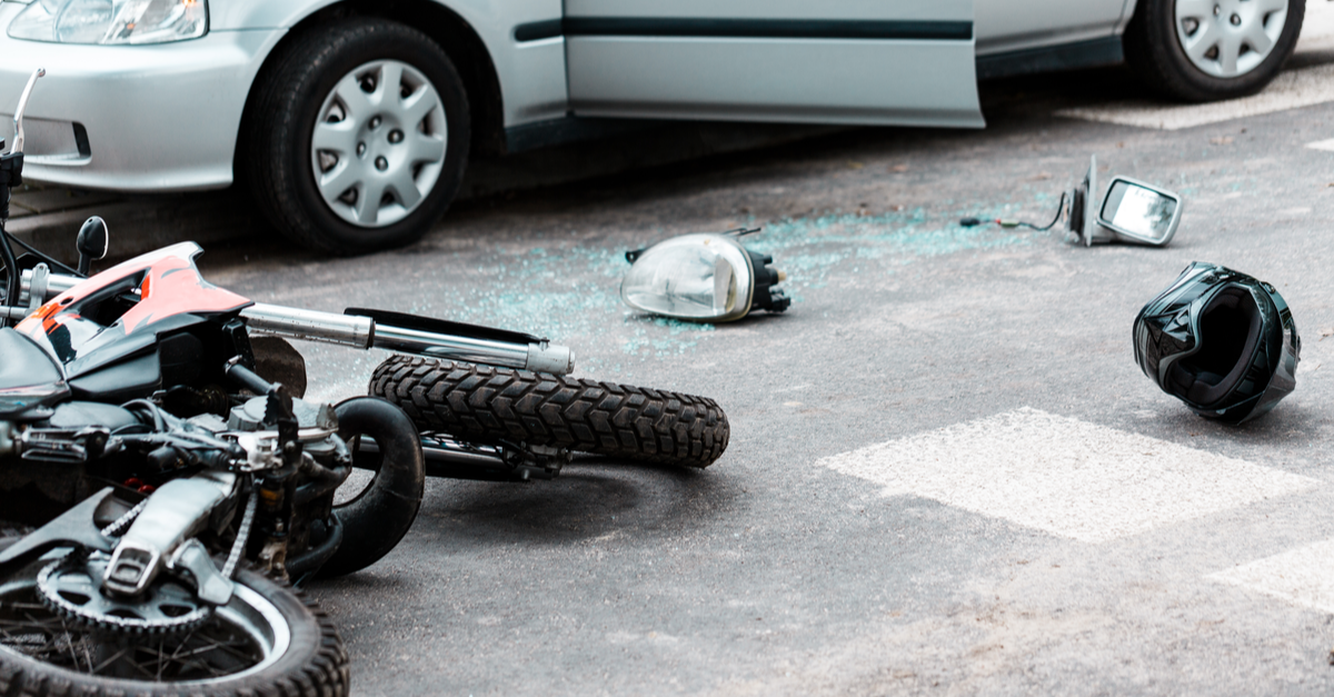 motorcycle and helmet on road after accident