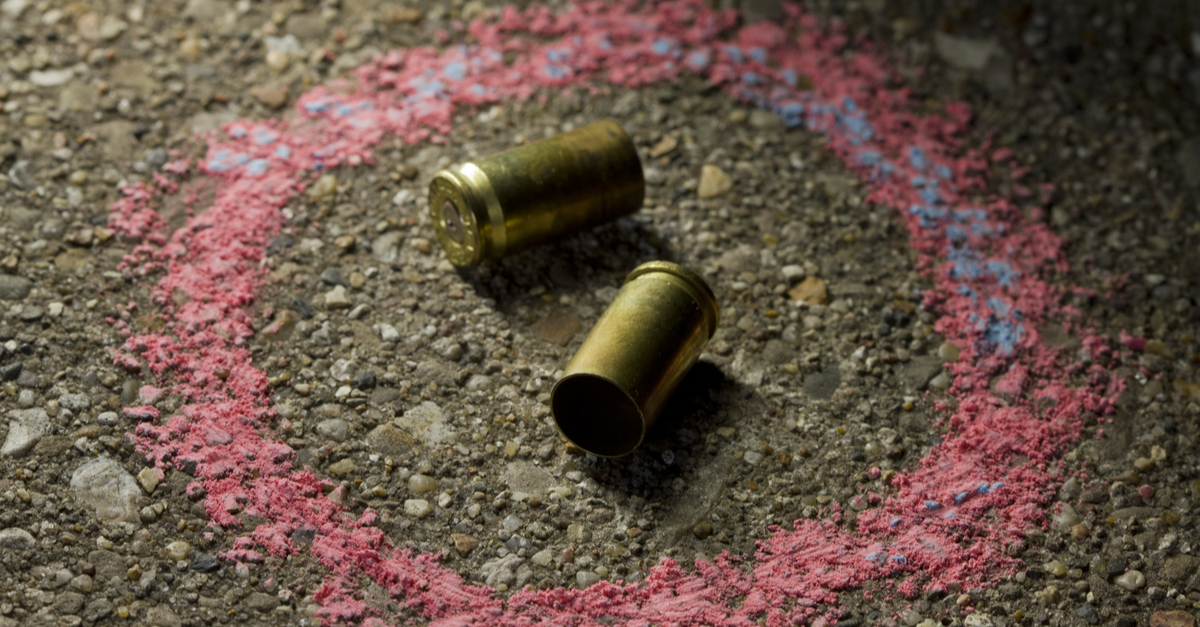 Bullets on ground with chalk drawn around