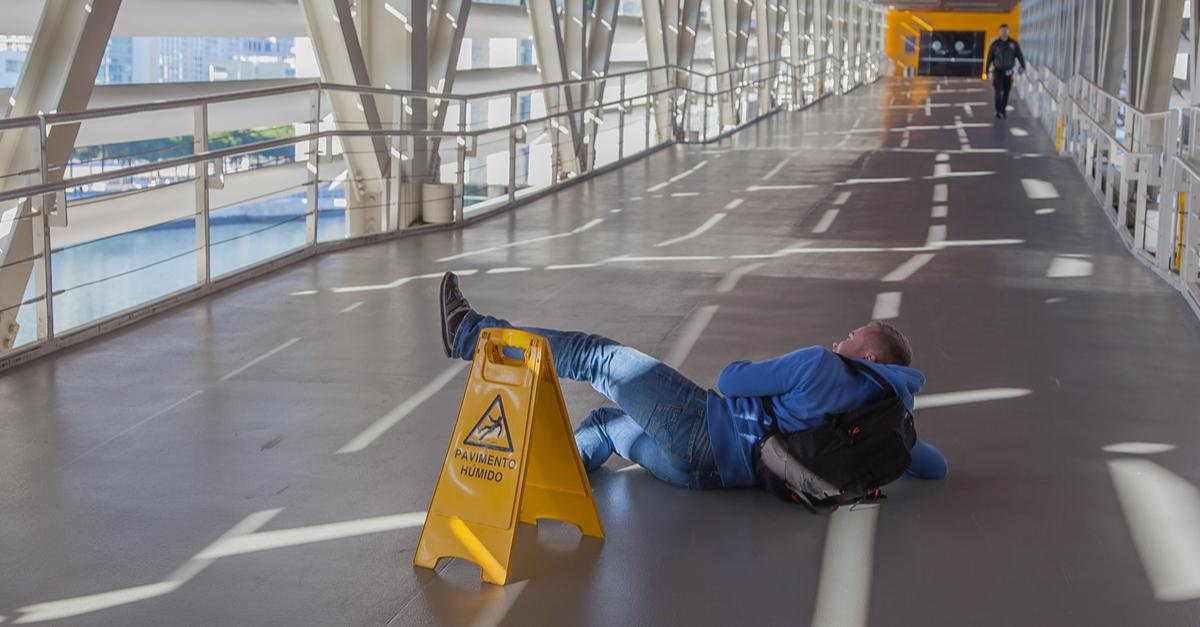 a man falling on wet floor