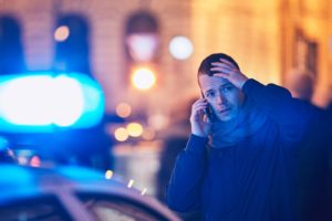man on Long island contacting a car accident lawyer