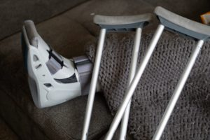 crutches and boot on someone who had a slip and fall injury in NY