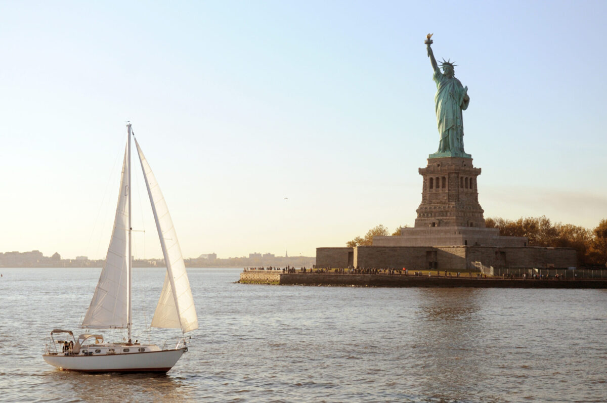sail boating in new york, near the statue of liberty