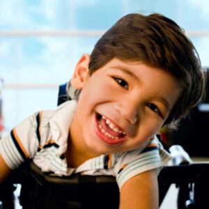 little boy with cerebral palsy smiling