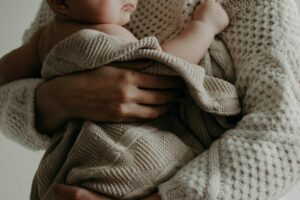 holding baby with birth injury