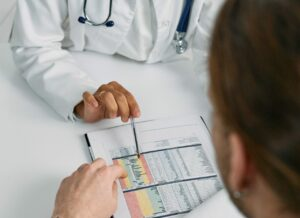 pediatrician reviewing medical charts for patient