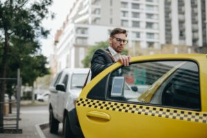 man getting into a New York taxi