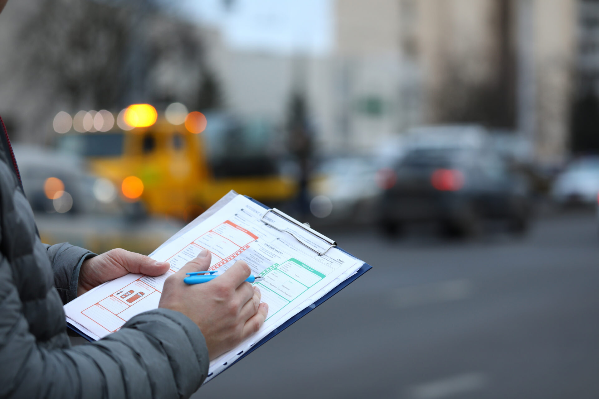 man filling out a police report after an accident on Long Island