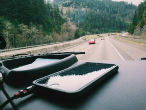 smartphone on the dash of a car, driving in upstate New York
