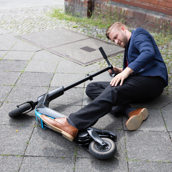 young man got an accident with an electric scooter