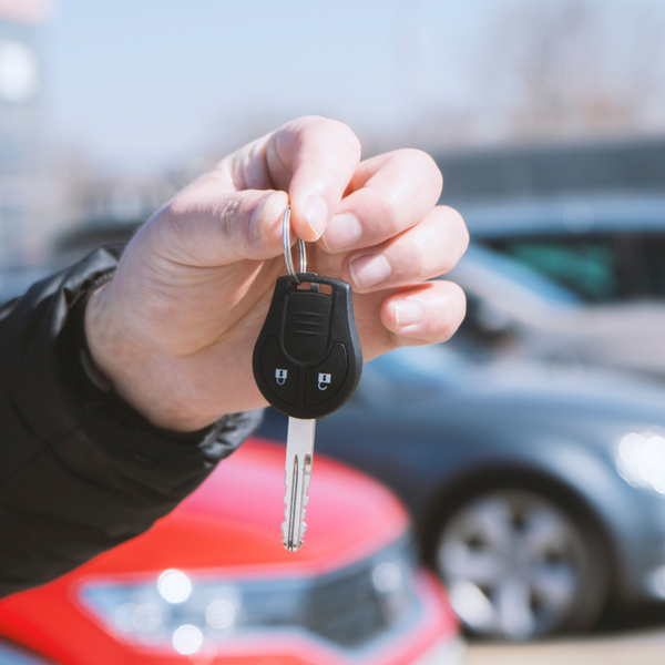 a man holding car keys