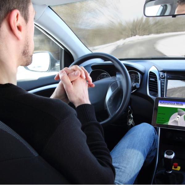 man with an autonomous driving vehicle