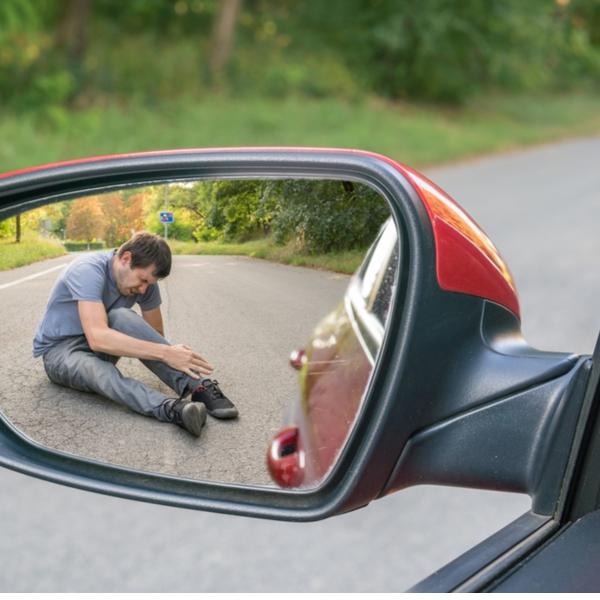 a pedestrian getting hit by a car