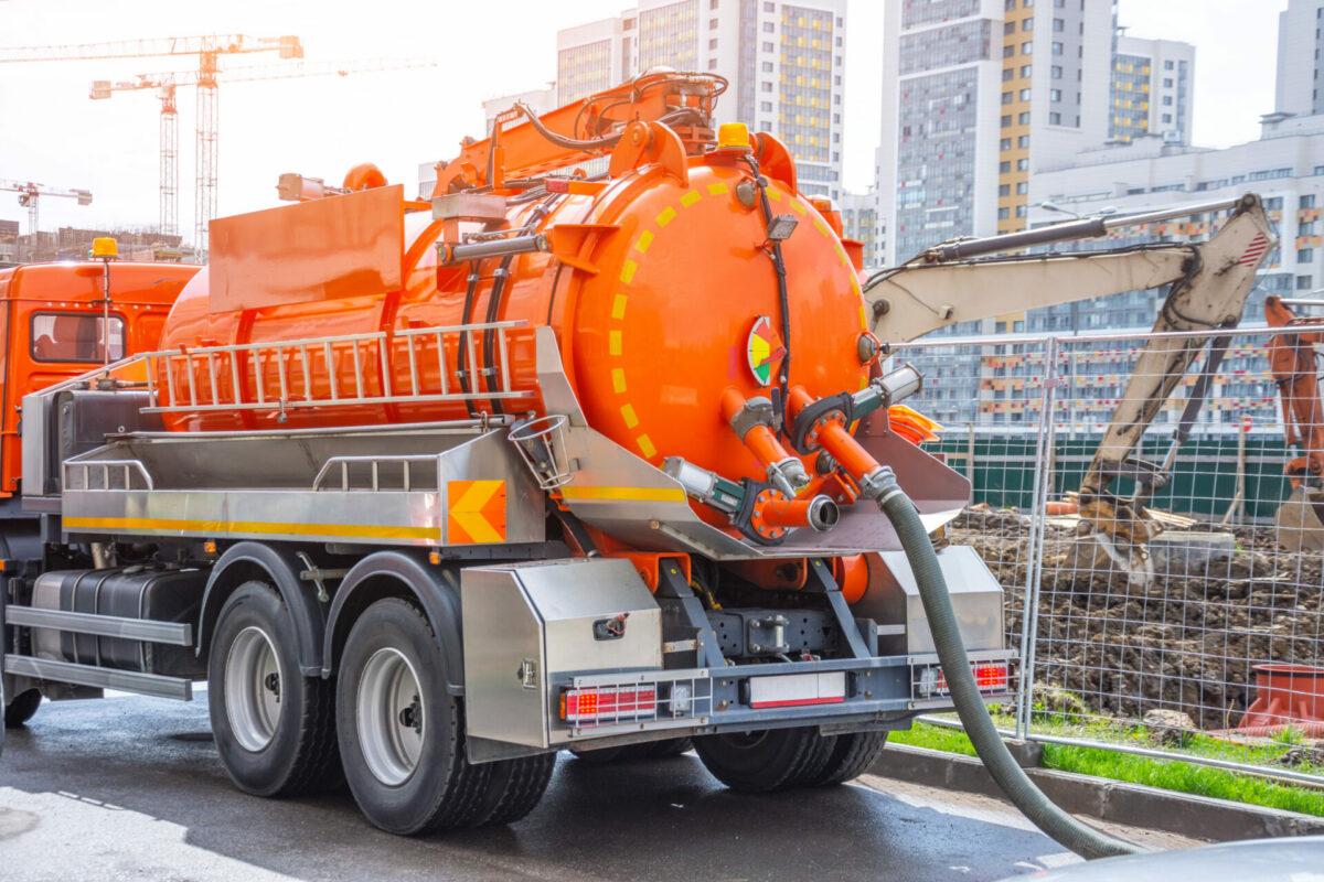 Orange sanitation truck in New York City